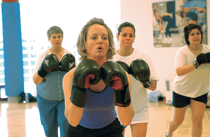 Woman in front of a kickboxing class